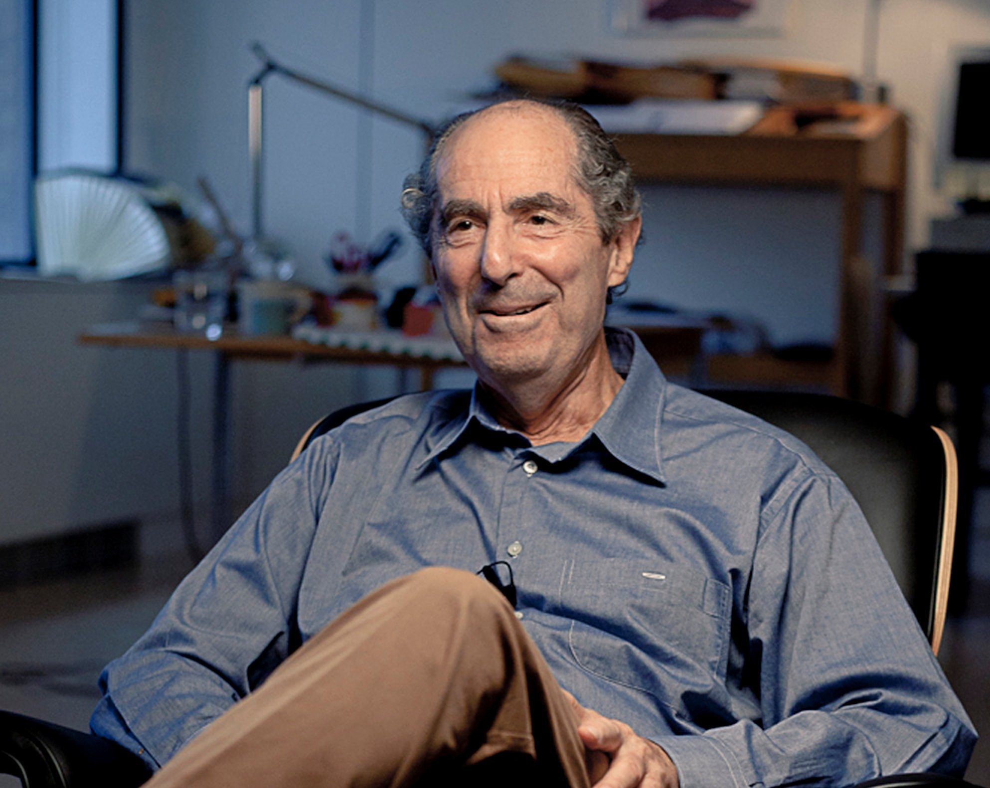"View full size Acclaimed novelist Philip Roth being interviewed in his Manhattan apartment for the ""American Masters"""
